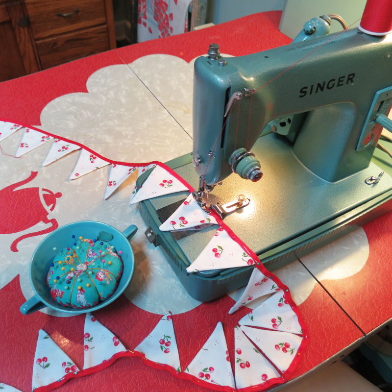 Sewing a cherry pennant